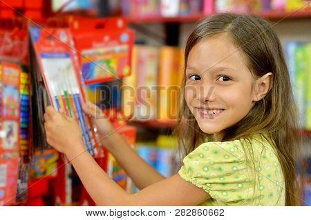 Portrait Of Girl Choosing Bruches In Store