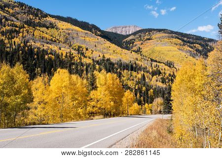 Fall is in full intensity along the San Juan Skyway north of Durango Colorado. poster
