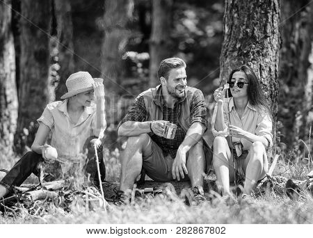 Camping And Hiking. Halt For Snack During Hiking. Company Friends Relaxing And Having Snack Picnic N