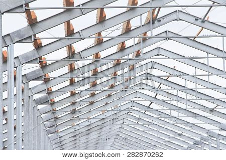 Part Of The Building Structure Of Galvanized Parts. Galvanized Parts On A Construction Site In Rainy