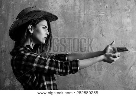 Pretty Girl Or Beautiful Woman With Blond, Long Hair In Stylish Cowboy Hat And Red Plaid Shirt Showi