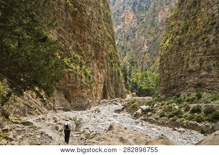 Trekking On A Path Through Samaria Gorge Near Iron Gate, South West Part Of Crete Island, Greece
