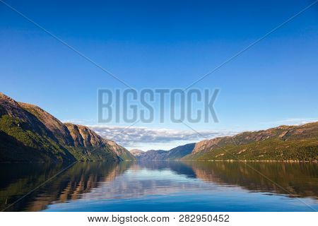 Calm morning at Lysefjord (Lysefjorden) fjord, a popular travel destination in Forsand municipality of Rogaland county, Norway, Scandinavia