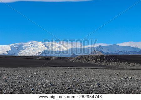 Ice Chunks On The Black Beaches Of Iceland
