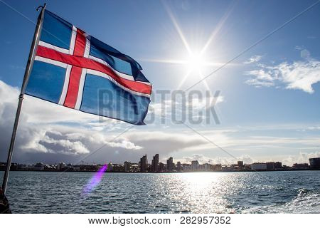 Iceland Flag Blowing In The Wind At Sunset In Reykjavik, Iceland