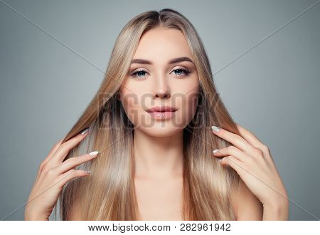 Blonde Hair Woman. Beautiful Model Girl With Long Straight Healthy Hairstyle. Haircare, Hair Styling