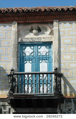 Old Door With Balcony