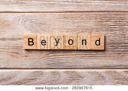 Beyond Word Written On Wood Block. Beyond Text On Wooden Table For Your Desing, Concept