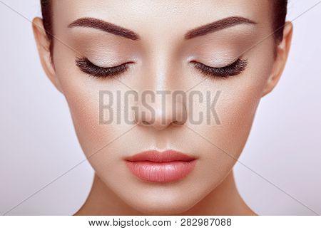 poster of Beautiful Woman with Extreme Long False Eyelashes. Eyelash Extensions. Makeup, Cosmetics. Beauty, Skincare