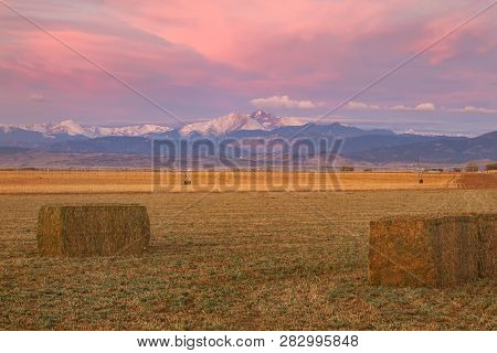 Sunrise Over Longs Peak With Harvested Crops In The Foreground
