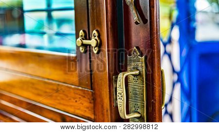 Close Up Of The Lock Of A Sliding Door In The Famous Tramvia Blau (blue Tram, Opened In 1901) In Bar