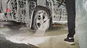 Man worker washing cars alloy wheels on a car wash. Car wash Wash the car at the car wash. poster