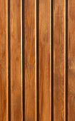 Wooden wall made of grained brown planks poster