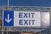 Exit Sign and Direction Arrows at Temporary Structure poster
