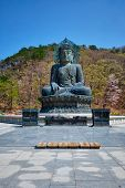 The Great Unification Buddha Tongil Daebul is a 14.6-meter 108 ton Bronze Buddha statue in Seoraksan National Park, South Korea. poster