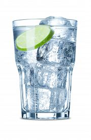 Water With Bubbles, Ice And Slice Of Lime In Glass