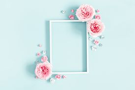 Flowers Composition. Photo Frame, Rose Flowers On Pastel Blue Background. Valentines Day, Mothers Da