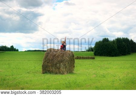 Girl Sitting On A Haystack, Autumn Haymaking