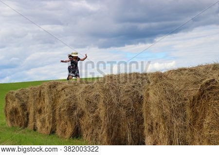 Girl Runs On A Haystack, Autumn Haymaking