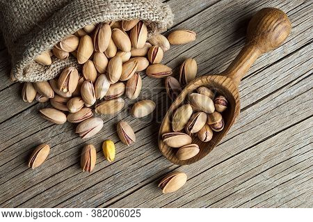 Top View Pistachio In Nutshell On Wooden Rustic Backdrop, Composition Of Pistachios Great For Health