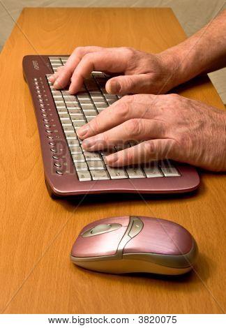 Mans Hands On Feminine Keyboard