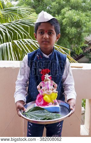 Kalaburagi, Karnataka/india-august 22.2020: Boy Bringing Colorful Idol Ganesha To Home For Ganesha C