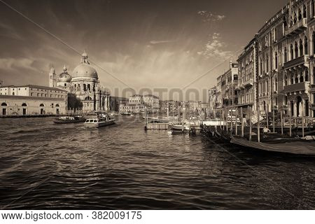 Waterfront view of Venice Church Santa Maria della Salute and canal in Italy.