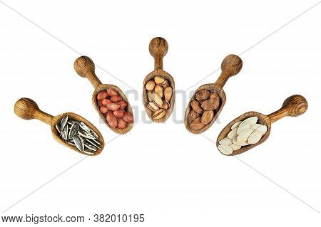Nuts Mix Dried Fruits In Wooden Shovel Or Spoon, Different Kind Of Nut, Healthy Food On Wooden Table