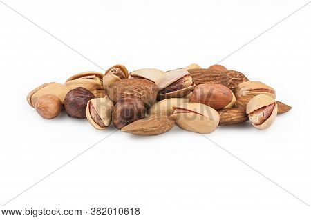 Nuts Mix Dried Fruits Isolated On White Background, Different Kind Of Nut, Healthy Food On Wooden Ta