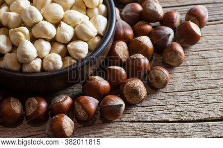 Hazelnuts, Filbert In Burlap Sack And In Bowl On Brown Vintage Table. Heap Or Stack Of Hazelnuts. Ha