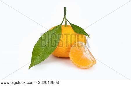 Yellow Sweet Isolated Peeled And Whole Mandarin Clementine Tangerine On White Copy Space With Leaf.