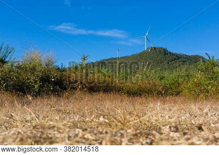 Low Angle View Of The Wind Turbine On Green Mountain