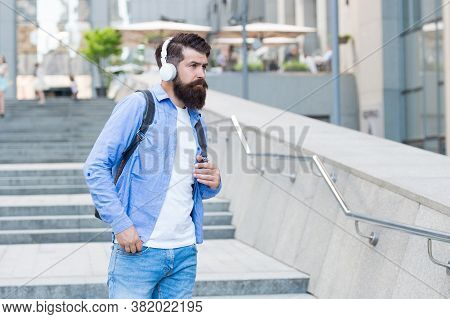 Daily Route To Work. Modern Life. Change Of Scenery Concept. Handsome Hipster With Backpack Walking