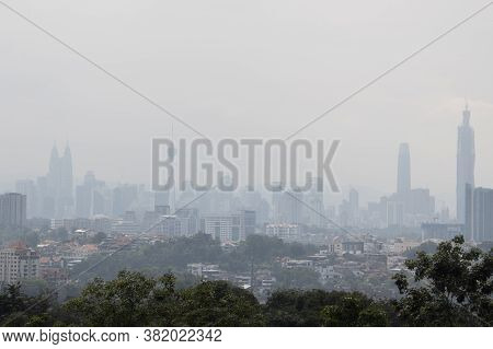 Hazy Kuala Lumpur City Skyscape Due To  Haze From Forest Fire