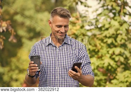 Waiting For Message. Modern Life Demands Modern Gadgets. Man With Smartphone Drinking Coffee. Mobile