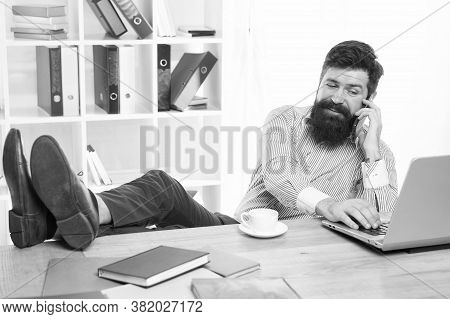 Business Communication. Bearded Man Talk On Phone In Office. Communication With Customers. Computer