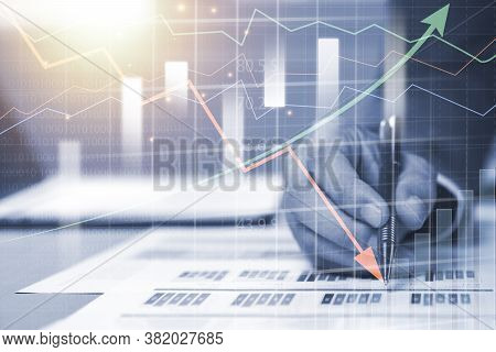 Double Exposure Of Businessman Writing On Investment Graph With Virtual Graph. Investment Analysis A