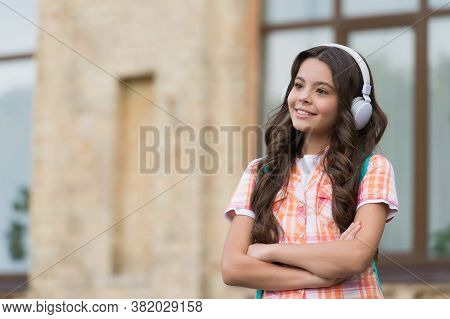 Technology To Improve Language Learning. Happy Child Wear Headphones. Foreign Language Courses. Engl