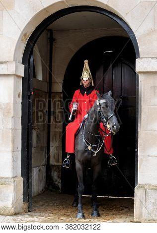 Mounted Soldier Of The Queen's Life Guard, Whitehall 2020. The Soldier Is Guarding The Entrance To H