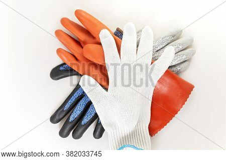Chemical Resistant And Cut Resistant Protective Safety Gloves In A Stack Against White