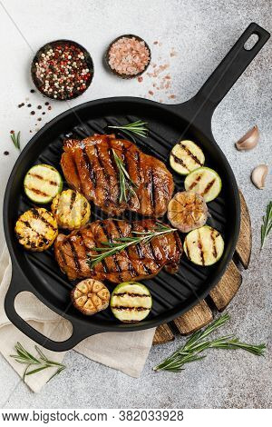 Grilled Meat With Vegetables In A Cast Iron Grill Pan. Grilled Pork With Grilled Vegetables