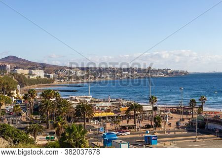 Playa Del Ingles, Spain - 5 Jan, 2020: View Of The Coastline Of Playa Del Ingles With Palm Trees And