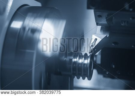 The  Cnc Lathe Machine Groove Cutting The Metal Pulley Parts. The Hi-technology Metal Working Proces