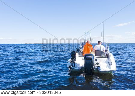 Fisherman On Boat At The Ocean. Beautiful Seascape With The Fishing Boat. Fishing Motor Boat With An