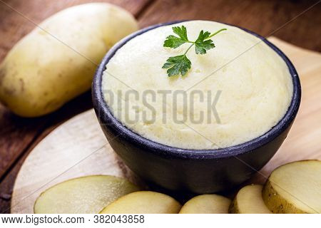 Brazilian Mashed Potato, On Rustic Background On Wooden Table. Organic Product.