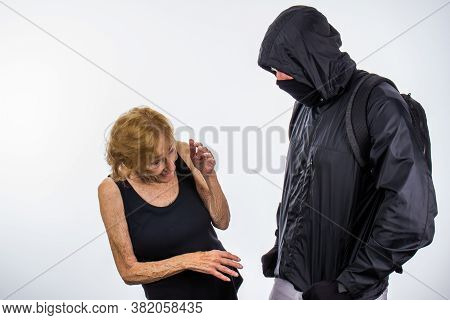 Protester With Face Mask & Back Pack Intimidates Small Senior Woman