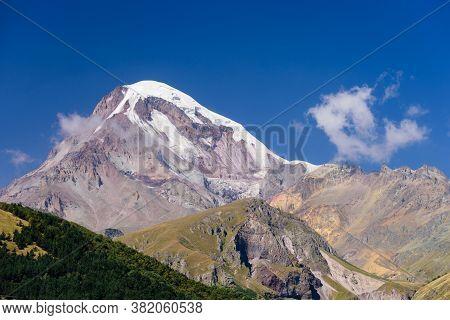 Mount Kazbegi Is A Popular Natural Attraction And Stepantsminda (kazbegi) Village, Georgia