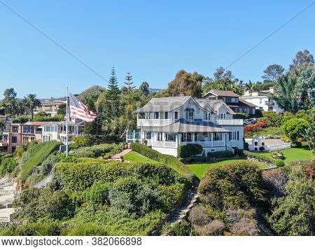 Aerial View Of Villa On The Cliff With American Flag In Laguna Beach, Southern California Coastline,