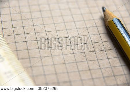Graph Paper Of Notebook Background, Blank Page Of Retro Sketchbook With Old Pencil And Ruler. Close