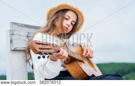 Learn To Play The Guitar Diligently. Girl Enjoy The Moment. Have Fun On Celebration. Kid Singing Wit
